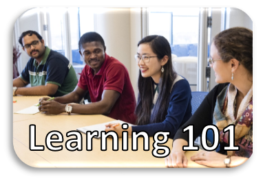 Four people sitting at a table conversing with Learning 101 written on the photo.