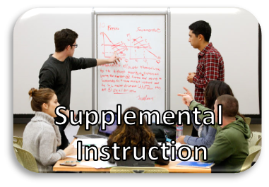Four people sitting at a table, two people are standing at the whiteboard with Supplemental Instruction written on the photo.