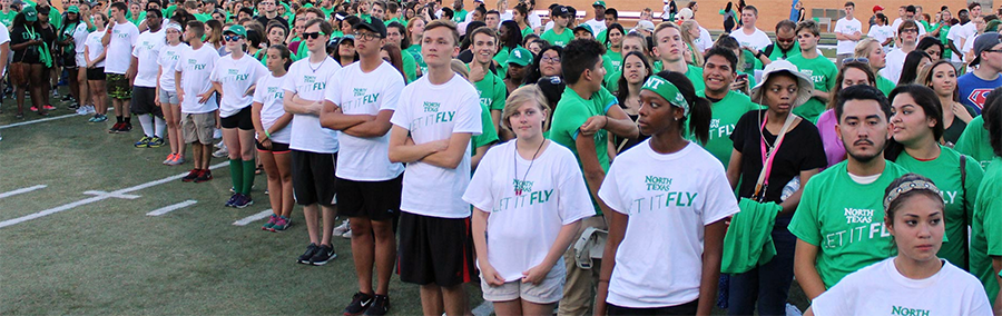 Photo of dozens of new UNT students in UNT T-shirts.