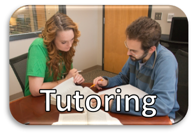 Photo of two people looking at study materials with Tutoring Services written on the photo